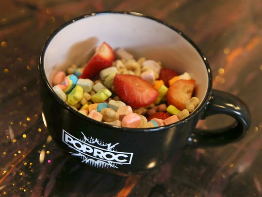 A bowl of mixed cereals with added fresh fruit toppings