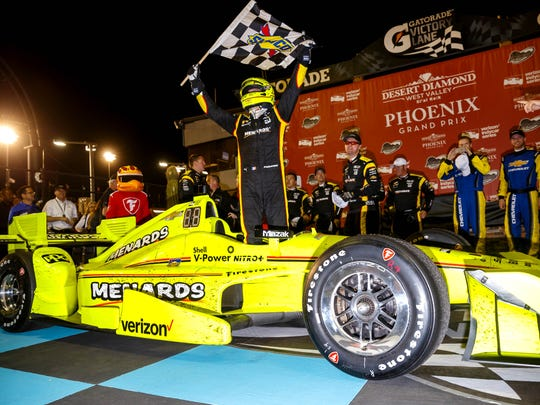 IndyCar Series driver Simon Pagenaud celebrates after winning the Desert Diamond West Valley Phoenix Grand Prix at Phoenix International Raceway.