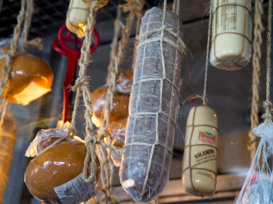 The meats and cheeses hang in the kitchen at The Sicilian