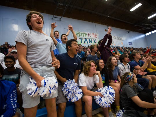 Students cheer during a pep rally at Port Aransas High School on April 5. Community leaders say supporting housing where families can afford to live is critical to maintaining student enrollment.