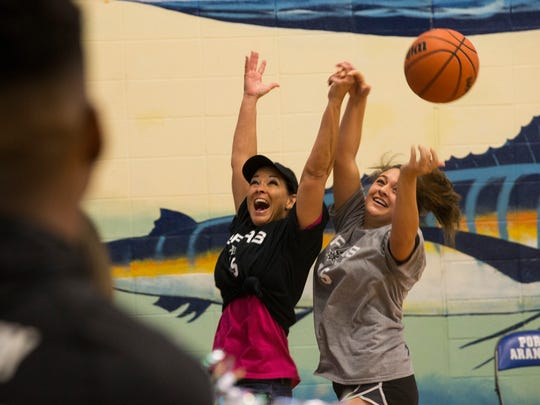 Robin Delgado (right) steals the ball from a faculty member during the  student vs. faculty basketball game part of the pep rally put on by the San Antonio Spurs on Thursday, April 5, 2018 and Port Aransas High School.