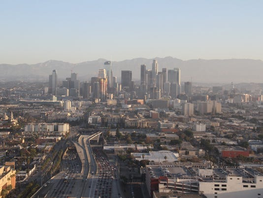 636585455113276597-04-AA-LA24-medium-shot-of-downtown-L.A.-buildings-looking-NE-up-the-110-freeway.JPG