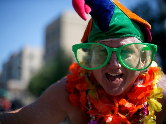 Kenny Ayers enjoys the festivities at the Springtime Tallahassee parade downtown on Saturday.