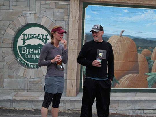 Black Mountain Greenway Challenge runners enjoy a beer in front of Pisgah Brewing Co. after the race.