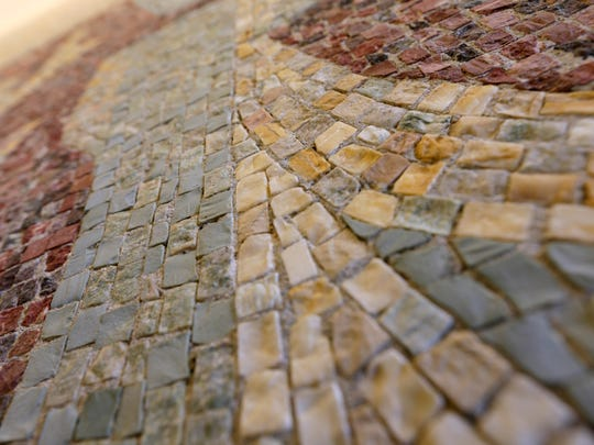 A detail view of the small stone tiles that make up artist Marjorie Kreilick's large mosaics at the downtown State Office Building.