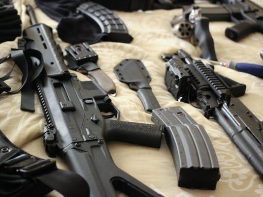 Bed Full of guns