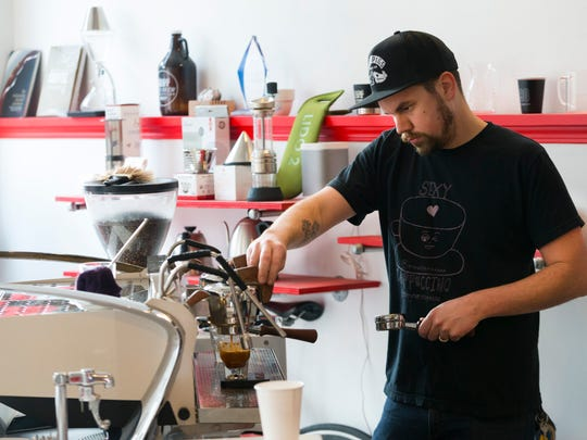 Barista Sam Brown works behind the counter at  Pilcrow.