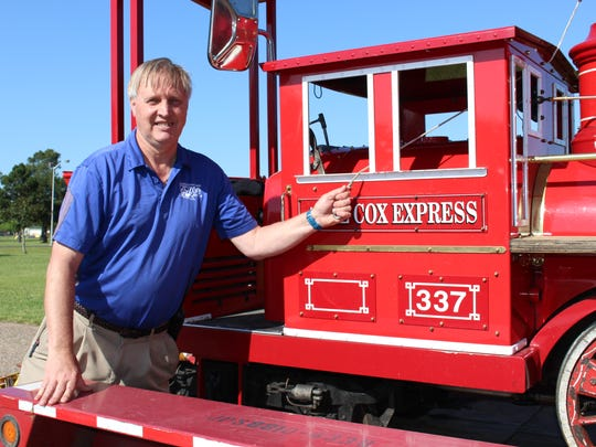 Zoo Director Joe Clawson rings the bell on the new train engine at Louisiana Purchase Gardens & Zoo.