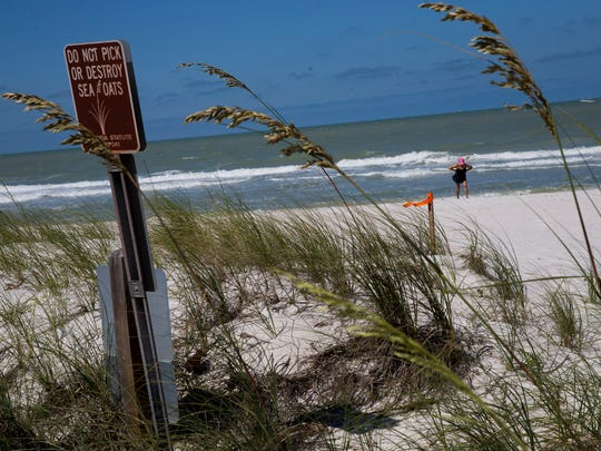 A red marker indicates an available rental slip at the 17th Avenue South beach access point Wednesday, April 11, 2018 in Naples. The sand location, along with four other beach locations and two other locations with kayak racks, are available through the city's Boats on the Beach program. The city is considering ending the program.