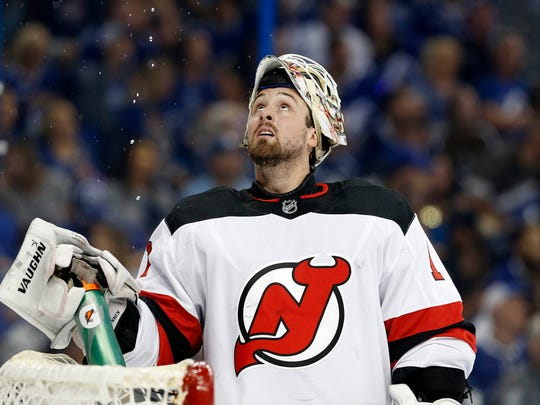 Apr 14, 2018; Tampa, FL, USA; New Jersey Devils goaltender Keith Kinkaid (1) sprays water during the first period of game two of the first round of the 2018 Stanley Cup Playoffs against the Tampa Bay Lightning at Amalie Arena.