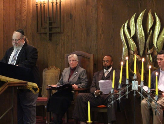 Congregation president Paul Hyman speaks during the