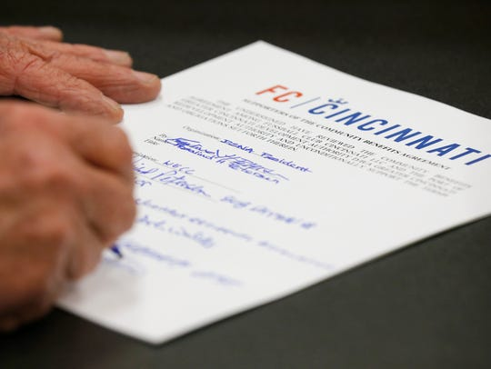 Stakeholders sign the new agreement during a press