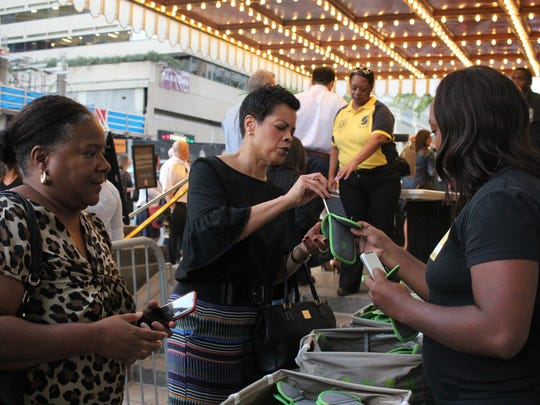 Attendees at a Dave Chappelle show in Washington last year place their phones in a portable pouch provided by Yondr.