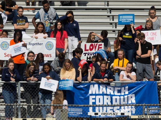 Students at Naples High School, in an effort to revive gun reform action, walkout of school on the 19th anniversary of the Columbine shooting Friday, April 20, 2018 in Naples. Walkouts were planned at 2,500-plus schools throughout the country after talks about gun reform have stalled since the Parkland shooting two months ago.