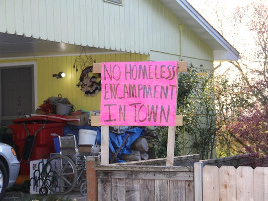 A sign across the street from St. Edward's Episcopal Church in Silverton protesting the church's proposal to add temporary housing for homeless.