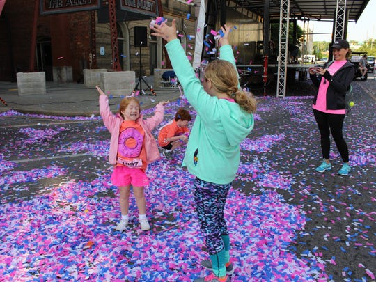 Children had fun chasing colorful confetti as it fluttered around them at the starting line at Saturday's Joy to Life event.