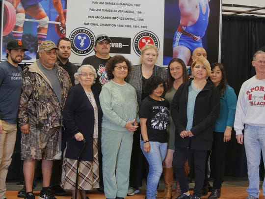 The family of Mario Martinez, Jeremy Graves(far left) and his longtime weightlifting coach Jim Schmitz(far right).
