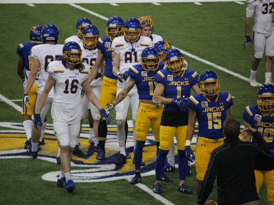 SDSU players warm up before Friday's spring game