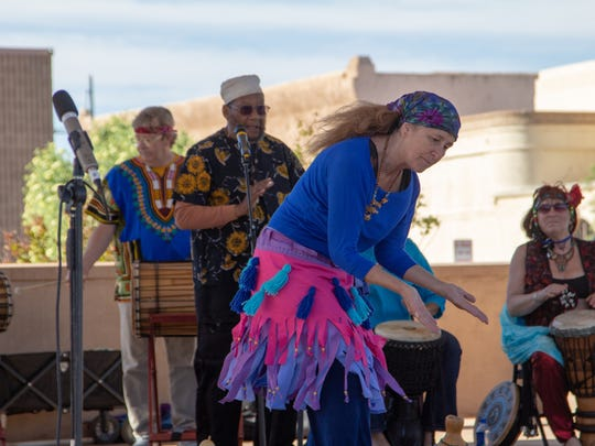 Members of the Karuna Warren New World Drummers dance and play for crowds at the Earth Day celebration on April 21, 2018 at the Plaza de Las Cruces.