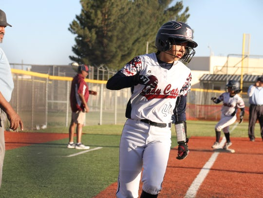 Pilar Garcia scores a run during Friday's 18-0 blowout