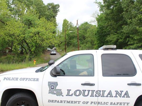 Police block off neighborhood streets near I-220 and