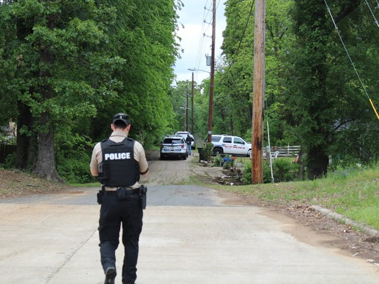 Police block off neighborhood streets near I-220 and Jefferson Paige Road as they search for a bank robbery suspect Monday morning.
