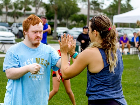 People work out at North Collier Regional Park on Saturday,