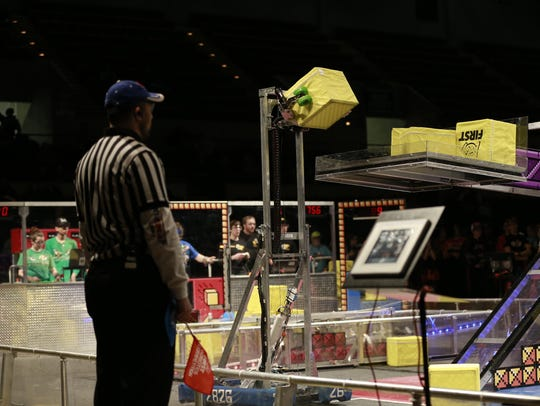 Wave's robot places a box on the scale.
