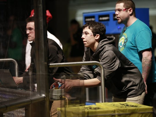 Kiran Loewenstein and Ryan Bal control Wave's robot.