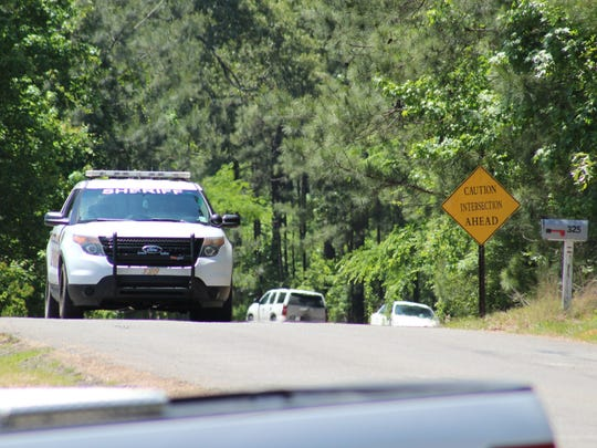 A Rapides Parish Sheriff patrol unit drives on Parker Road in the Cotile Lake area on Tuesday afternoon. Deputies, detectives and other law enforcement officers have been searching for a Boyce man suspected in an early Sunday home invasion in which a man was shot and a woman kidnapped. Both victims are recovering.