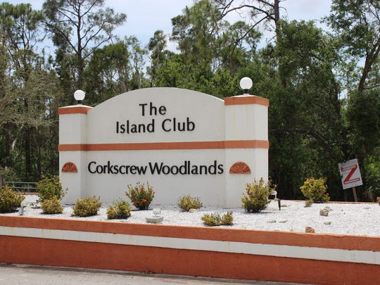 The entrance and exit of The Island Club and Corkscrew Woodlands.