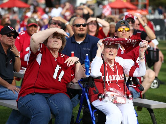 Cardinals fans watch the TV at the Arizona Cardinals