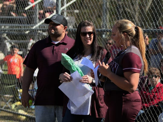 Ashley Valencia reads a letter to her parents Joey Valencia and Rhonda Thome before taking the field for her final regular season home game as a member of the Owen Warlassies.