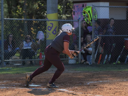 Owen senior Ashley Valencia hits a line drive to opposite field in an 11-0 victory against Mitchell on Senior Night for the Warlassies on April 27.