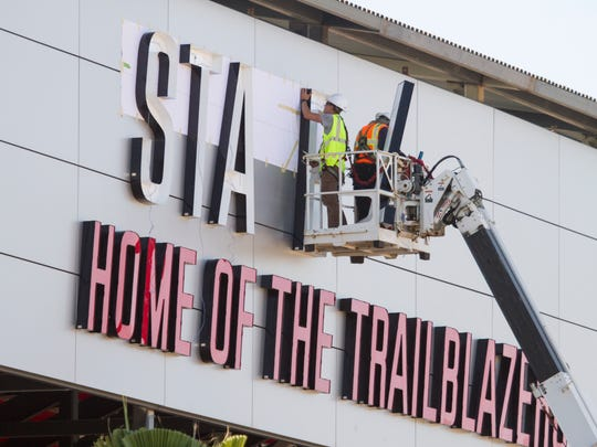 Crews install letters on the Dixie State University