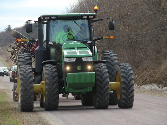 Farmers should not pull over in a no-passing zone to let vehicles pass, unless the road shoulder condition and width can allow for the farm machinery to completely move onto the shoulder.