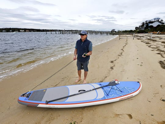 "Rich Bubnowski , owner of ""Paddle Surf New Jersey,"""