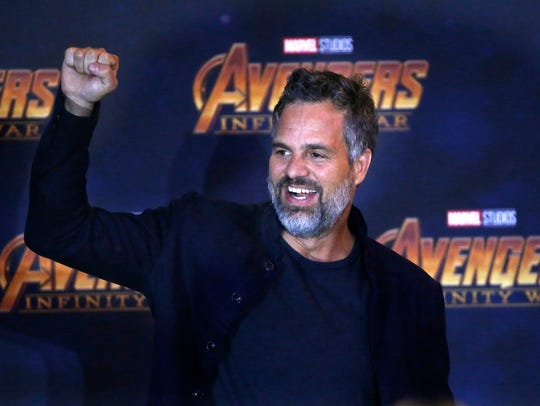 Mark Ruffalo cheers on the crowd at a press conference