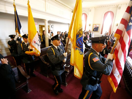 The Morris County Sheriff's Honor Guard presents the