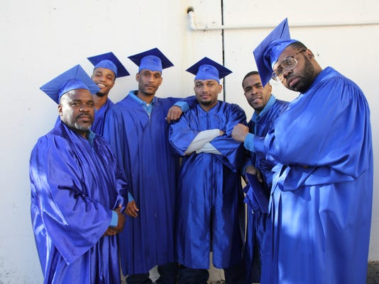 636610249568649271-Group-2-graduates.JPG