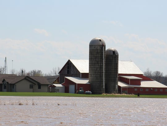 Flooded fields surround this farm in Calumet County last May.