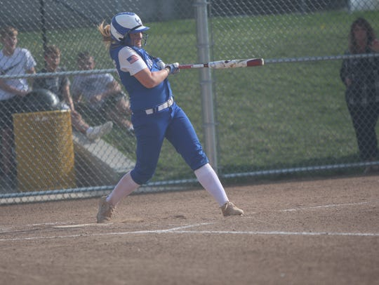 Oak Creek's Jenna Trewyn follows through on an RBI