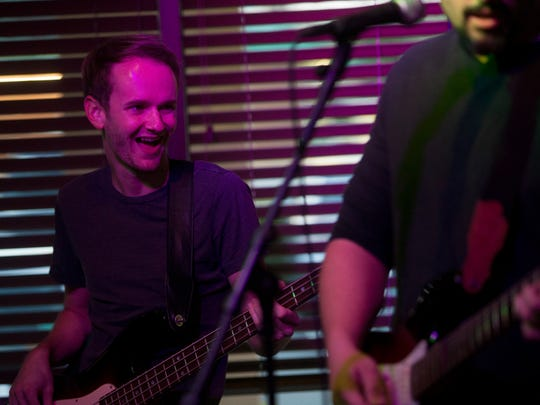 Them Hamilton Boys bassist Eddie Krzeminski can't help but smiling while playing with the band at Dylan's Drafthouse along Airport Pulling Road Friday, May 4, 2018 in Naples. The band plays its own, original music as well as a mix of country, classic rock, and southern rock tunes.