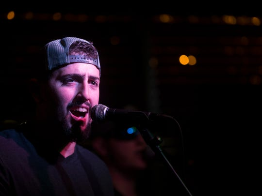Them Hamilton Boys lead singer Nick Hamilton performs at Dylan's Drafthouse along Airport Pulling Road Friday, May 4, 2018 in Naples. The band plays its own, original music as well as covering country, classic rock, and southern rock tunes.