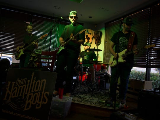 Southwest Florida southern rock band Them Hamilton Boys, comprised of brothers Nick Hamilton (Vocals & Guitar) and Hayden Hamilton (Vocals & Guitar), along with Doug Meier (Drums), and Eddie Krzeminski (Bass) perform at Dylan's Drafthouse along Airport Pulling Road Friday, May 4, 2018 in Naples. The band plays its own, original music as well as covering country, classic rock, and southern rock tunes.