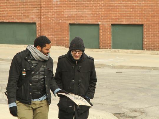 Actor Geno Walker (left) and playwright Brett Neveu