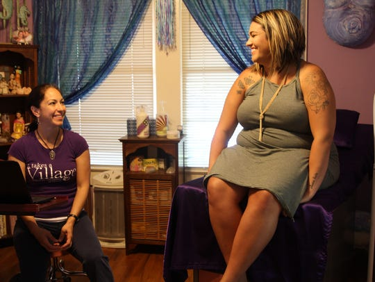 Heather Futrell, right, shares a laugh with her midwife