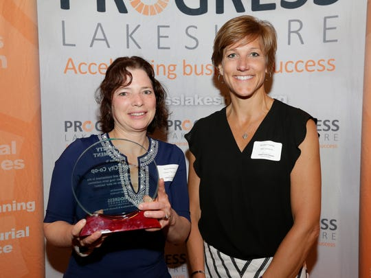Clipper City Co-op's Naomi Raddatz, left, accepts the Commnity Enhancement Award from R&R Insurance's Michelle Foehlke during the Progress Lakeshore Awards Breakfast at the Holiday Inn Tuesday, May. 15, 2018, in Manitowoc, Wis. Josh Clark/USA TODAY NETWORK-Wisconsin
