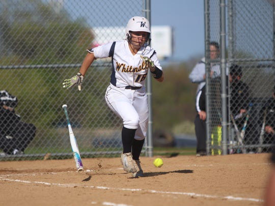 Whitnall's Haley Wynn heads to first base after dropping
