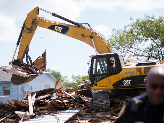 A house is demolished in Operation Crackdown on Wednesday,